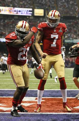 Following that third-quarter TD, Gore makes like Colin Kaepernick. The 49ers scored 17 consecutive points after falling behind 28-6. Photo: Michael Macor, The Chronicle