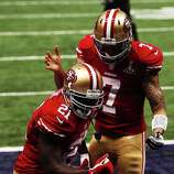 NEW ORLEANS, LA - FEBRUARY 03:  (L-R) Frank Gore #21 and Colin Kaepernick #7 of the San Francisco 49ers celebrate after Gore scored a 6-yard rushing touchdown in the third quarter against the Baltimore Ravens during Super Bowl XLVII at the Mercedes-Benz Superdome on February 3, 2013 in New Orleans, Louisiana.