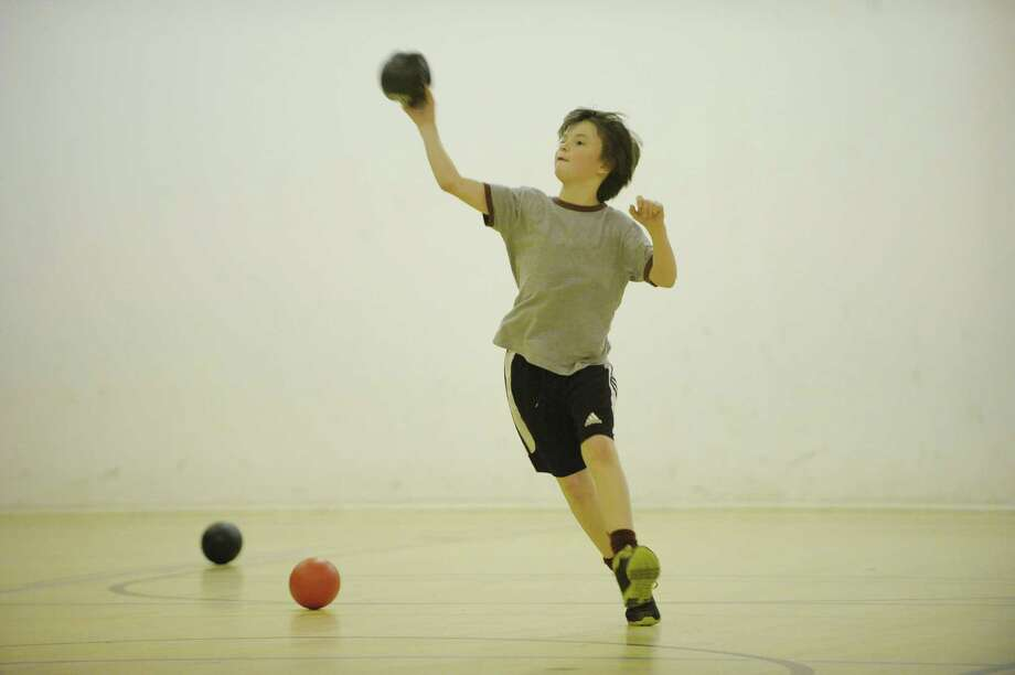 Justin Martinez, 13, from Burnt Hills throws the ball during a dodgeball program at the Schenectady JCC on Sunday, Feb. 3, 2013 in Niskayuna, NY.  The Schenectady JCC will hold their annual Mid-Winter Summer Blowout open house event on Sunday Feb. 10th.  (Paul Buckowski / Times Union) Photo: Paul Buckowski  / 00020826A