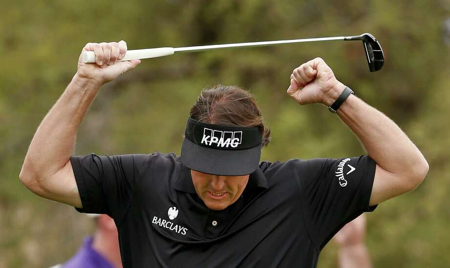 Phil Mickelson pumps his arms as he celebrates a long birdie putt on the seventh hole during the final round of the Waste Management Phoenix Open golf tournament on Sunday, Feb. 3, 2013, in Scottsdale, Ariz. (AP Photo/Ross D. Franklin) Photo: Ross D. Franklin