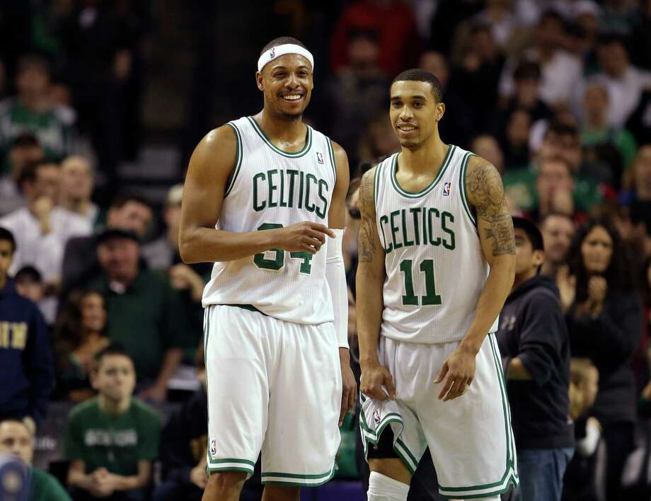 Boston Celtics forward Paul Pierce (34), left, and Celtics guard Courtney Lee (11), right, react seconds after the end of an NBA basketball game against the Los Angeles Clippers in Boston, Sunday, Feb. 3, 2013. The Celtics defeated the Clippers 106-104. (AP Photo/Steven Senne) Photo: Steven Senne