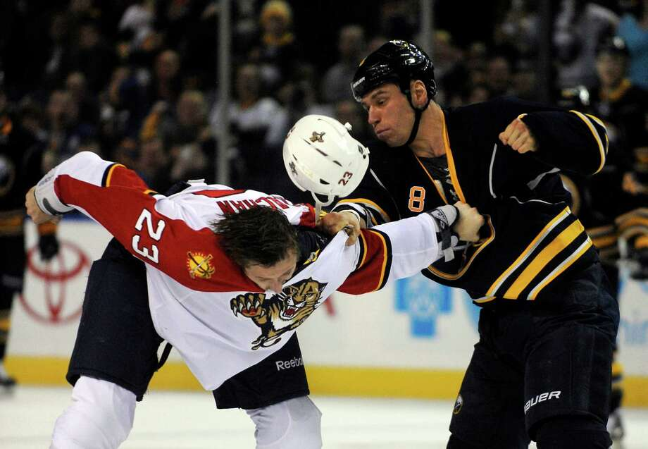Florida Panthers defenseman Tyson Strachan (23) loses his helmet during a fight with Buffalo Sabres center Cody McCormick (8) during the first period of an NHL hockey game in Buffalo, N.Y., Sunday, Feb. 3, 2013. (AP Photo/Gary Wiepert) Photo: Gary Wiepert