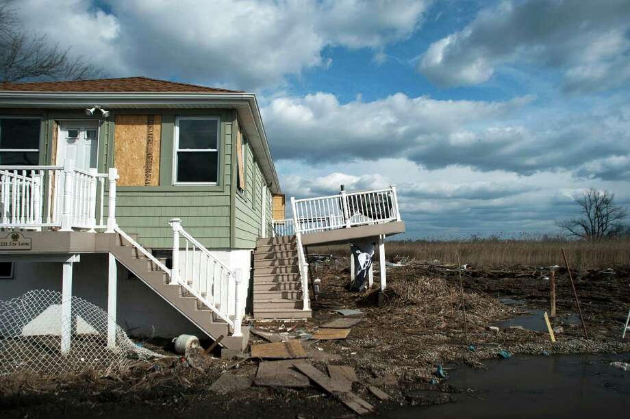A house damaged by Hurricane Sandy, in the Oakwood Beach area of the Staten Island borough of New York, Feb. 1, 2013. New York Gov. Andrew Cuomo is seeking to spend as much as $400 million to purchase and demolish homes wrecked by Hurricane Sandy, leaving the flood-prone land to be preserved as undeveloped coastline. (Karsten Moran/The New York Times) Photo: KARSTEN MORAN / NYTNS
