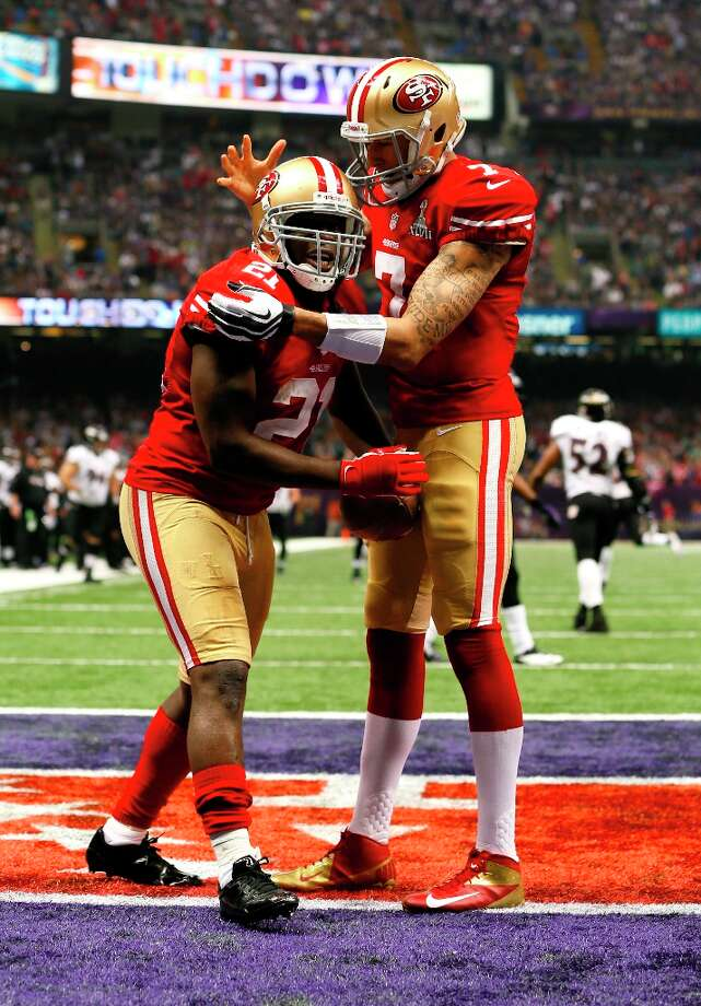 San Francisco 49ers Running back Frank Gore (21) celebrates with Quarterback Colin Kaepernick (7) after running in a touchdown in the third quarter of Superbowl XLVII between the San Francisco 49ers and the Baltimore Ravens at the Mercedes-Benz Superdome on Sunday February 3, 2013 in New Orleans, La. Photo: Michael Macor, The Chronicle / SFC