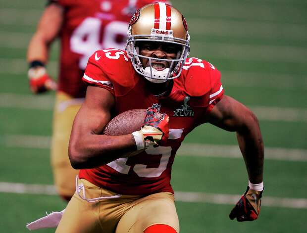 San Francisco 49ers wide receiver Michael Crabtree (15) scores on a 31-yard touchdown reception against the Baltimore Ravens during the second half of the NFL Super Bowl XLVII football game, Sunday, Feb. 3, 2013, in New Orleans. (AP Photo/Bill Haber) Photo: Bill Haber, Associated Press / FR170136 AP