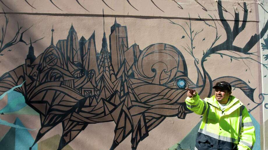 Houston mural artist Daniel Anguilu, says he sometimes doesn't know how a particular painting will look when finished, Wednesday, Jan. 30, in Houston. Anguilu explains that the buildings on the elephant's hump were made spontaneously. Photo: Nick De La Torre, Houston Chronicle / © 2013  Houston Chronicle