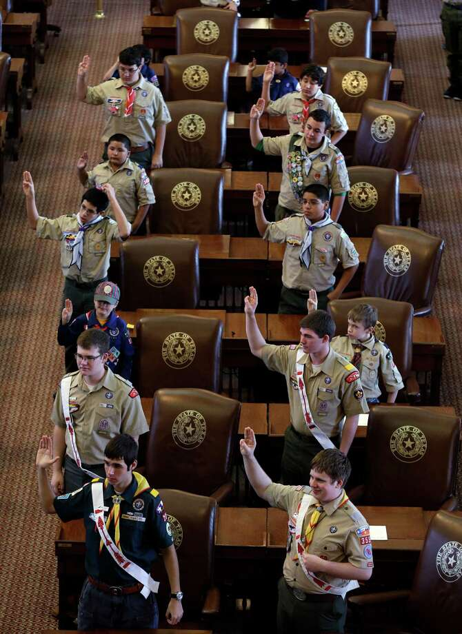 FILE - In this Feb. 2, 2013 file photo, Boy Scouts recite the Scout Oath during the annual Boy Scouts Parade and Report to State in the House Chambers at the Texas capitol, in Austin, Texas. President Barack Obama said Sunday, Feb. 3, 2013 that gays should be allowed in the Boy Scouts and women should be allowed in military combat roles. (AP Photo/Eric Gay, File) Photo: Eric Gay