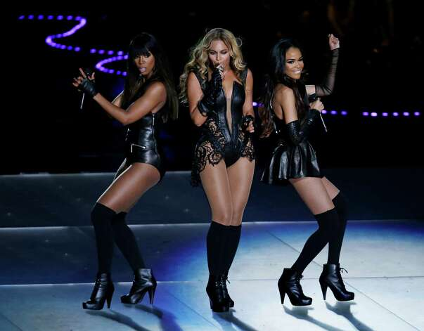 Beyonce performs with Kelly Rowland, left, and Michelle Williams, right, of Destiny's Child, during the halftime show of the NFL Super Bowl XLVII football game between the San Francisco 49ers and the Baltimore Ravens, Sunday, Feb. 3, 2013, in New Orleans. (AP Photo/Gerald Herbert) Photo: Gerald Herbert