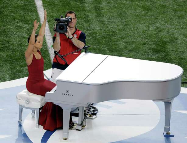 Alicia Keys reacts after singing the national anthem before the NFL Super Bowl XLVII football game between the San Francisco 49ers and the Baltimore Ravens, Sunday, Feb. 3, 2013, in New Orleans. (AP Photo/Charlie Riedel) Photo: Charlie Riedel