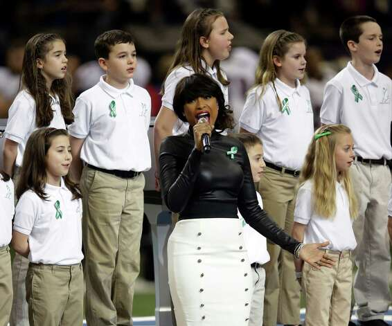 "Jennifer Hudson, center, sings ""God Bless America"" before the NFL Super Bowl XLVII football game between the San Francisco 49ers and the Baltimore Ravens, Sunday, Feb. 3, 2013, in New Orleans. (AP Photo/Evan Vucci) Photo: Evan Vucci"