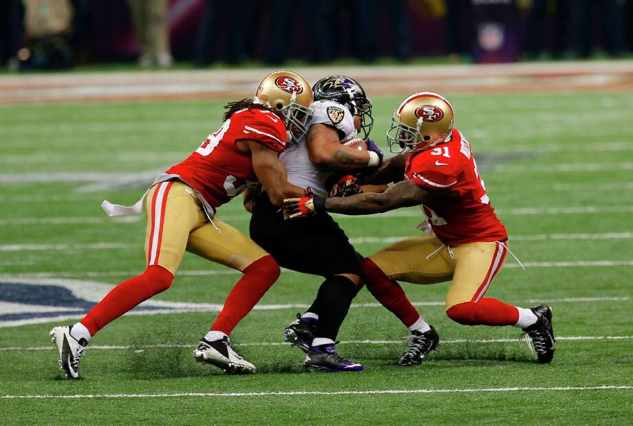 Running back Ray Rice (27) is tackled during the second half of Superbowl XLVII between the San Francisco 49ers and the Baltimore Ravens at the Mercedes-Benz Superdome on Sunday February 3, 2013 in New Orleans, La. Photo: Carlos Avila Gonzalez, The Chronicle / ONLINE_YES