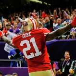 San Francisco 49ers running back Frank Gore (21) reacts after scoring a touchdown against the Baltimore Ravens during the second half of the NFL Super Bowl XLVII football game Sunday, Feb. 3, 2013, in New Orleans. (AP Photo/Julio Cortez)