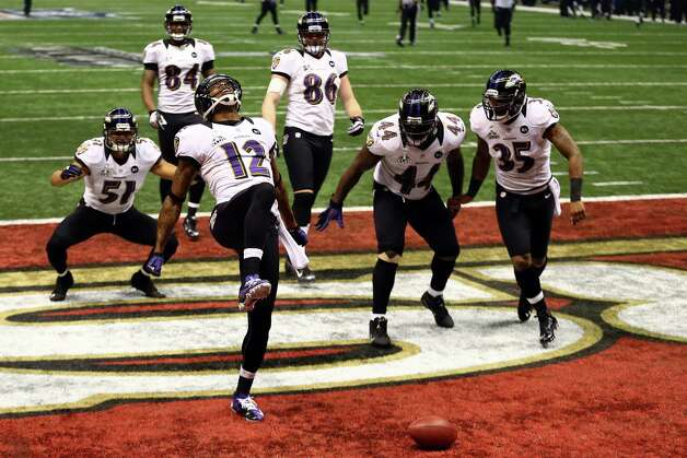 NEW ORLEANS, LA - FEBRUARY 03:  Jacoby Jones #12 of the Baltimore Ravens celebrates his record 109-yard kickoff return for a touchdown with his teammates in the third quarter against the San Francisco 49ers during Super Bowl XLVII at the Mercedes-Benz Superdome on February 3, 2013 in New Orleans, Louisiana. Photo: Al Bello, Getty Images / 2013 Getty Images