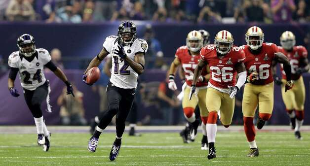 NEW ORLEANS, LA - FEBRUARY 03:  Jacoby Jones #12 of the Baltimore Ravens runs back a 108-yard kickoff return for a touchdown in the third quarter against the San Francisco 49ers during Super Bowl XLVII at the Mercedes-Benz Superdome on February 3, 2013 in New Orleans, Louisiana. Photo: Ezra Shaw, Getty Images / 2013 Getty Images