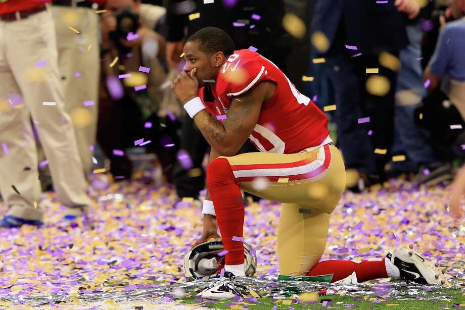 NEW ORLEANS, LA - FEBRUARY 03:  Perrish Cox #20 of the San Francisco 49ers kneels down among the confetti following their loss to the Baltimore Ravens during Super Bowl XLVII at the Mercedes-Benz Superdome on February 3, 2013 in New Orleans, Louisiana. The Ravens defeated the 49ers 34-31. Photo: Jamie Squire, Getty Images / 2013 Getty Images