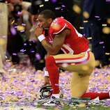 NEW ORLEANS, LA - FEBRUARY 03:  Perrish Cox #20 of the San Francisco 49ers kneels down among the confetti following their loss to the Baltimore Ravens during Super Bowl XLVII at the Mercedes-Benz Superdome on February 3, 2013 in New Orleans, Louisiana. The Ravens defeated the 49ers 34-31.