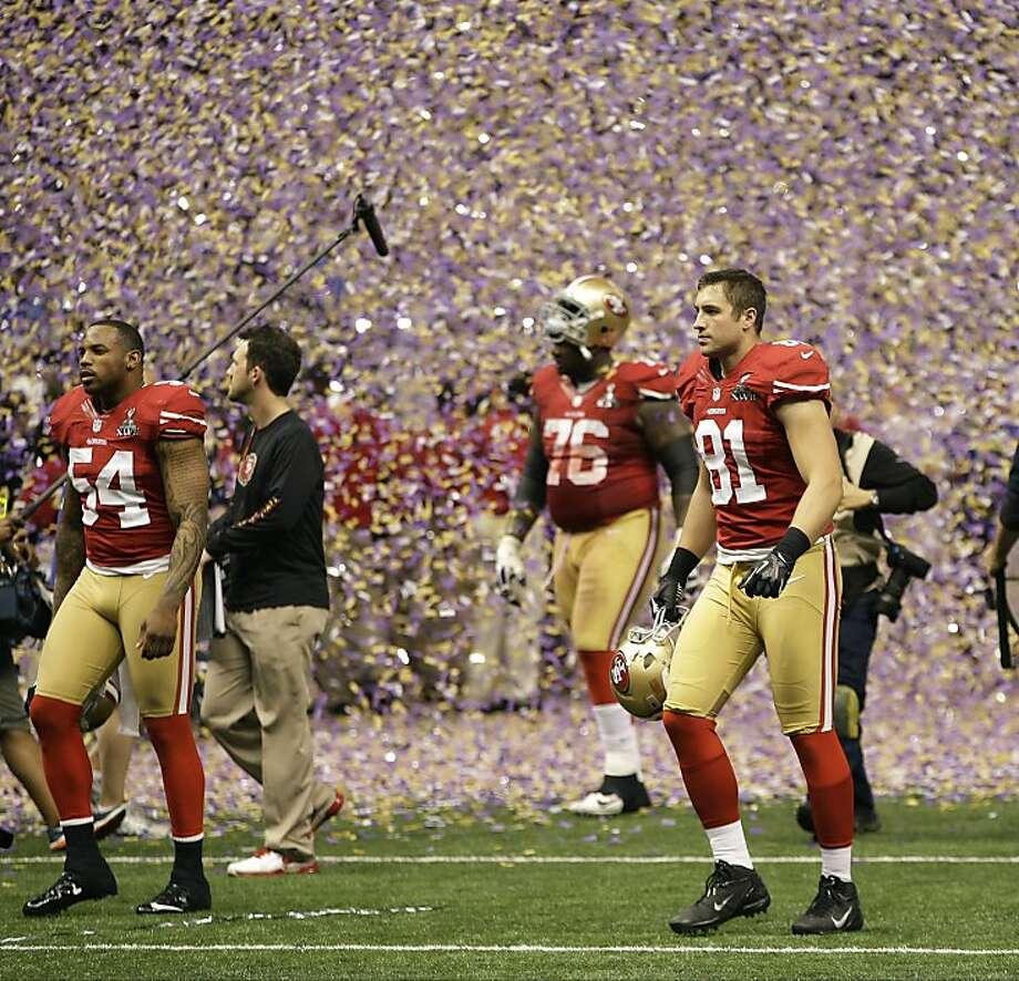 San Francisco players walk off field after Ravens' 34-31 win. Photo: Mark Humphrey, Associated Press