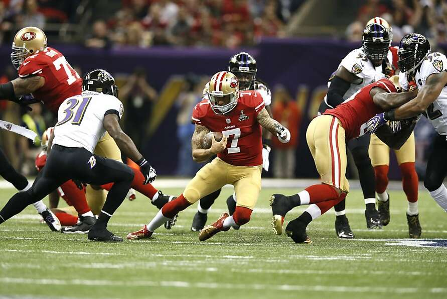 Quarterback Colin Kaepernick (7) breaks away for a run in the first half of Superbowl XLVII between