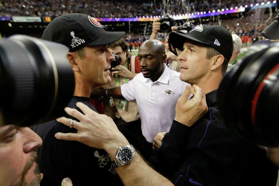 San Francisco 49ers head coach Jim Harbaugh, left, greets Baltimore Ravens head coach John Harbaugh after the Ravens defeated the 49ers 34-31 in the NFL Super Bowl XLVII football game, Sunday, Feb. 3, 2013, in New Orleans. (AP Photo/Dave Martin) Photo: Dave Martin, Associated Press / AP