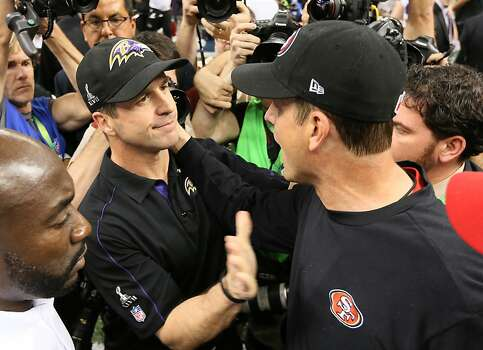 Brothers John and Jim Harbaugh meet at centerfield to shake hands after John and the Baltimore Ravens beat Jim and the San Francisco 49ers 34-31 in Superbowl XLVII at the Mercedes-Benz Superdome on Sunday February 3, 2013 in New Orleans, La. Photo: Michael Macor, The Chronicle