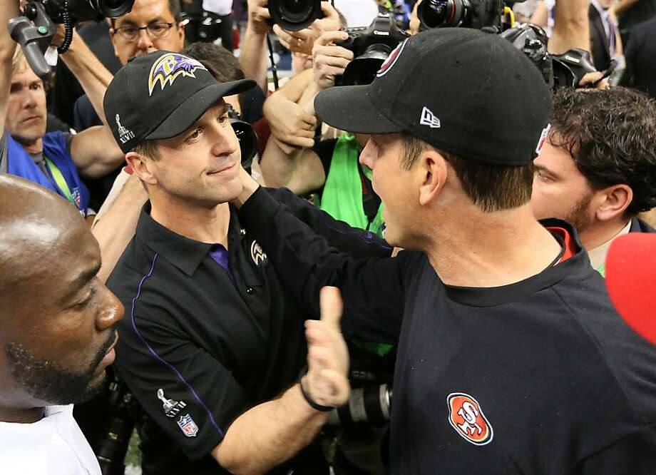 The Ravens' John Harbaugh (left) and the 49ers' Jim Harbaugh exchanged congratulations, and each later spoke with pride and admiration about the other. Photo: Michael Macor, The Chronicle