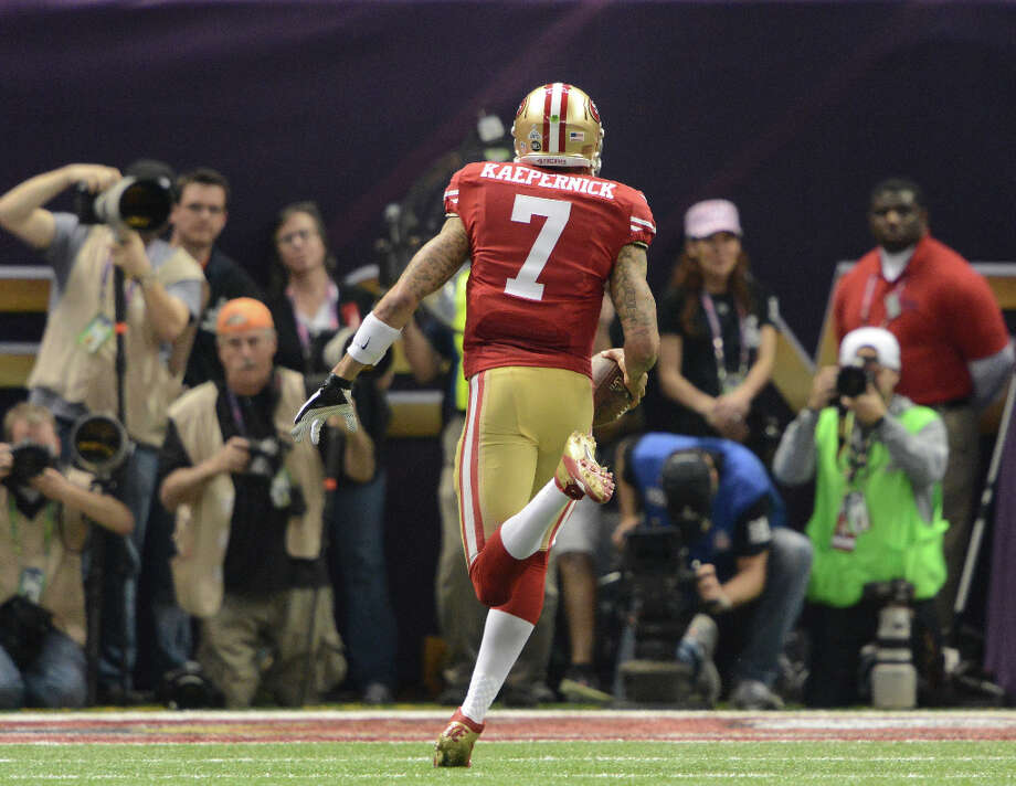Colin Kaepernick (7) of the San Francisco 49ers scrambles for a touchdown in the fourth quarter. Photo: Lionel Hahn