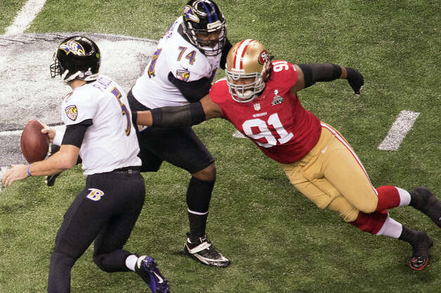 Baltimore Ravens quarterback Joe Flacco (5) scrambles away from San Francisco 49ers defensive end Ray McDonald (91). Photo: Smiley N. Pool / © 2013  Houston Chronicle