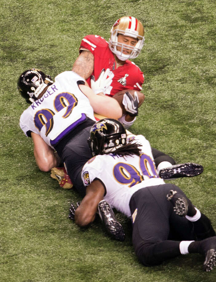 San Francisco 49ers quarterback Colin Kaepernick (7) is sacked by Baltimore Ravens outside linebacker Paul Kruger (99) during the first half. Photo: Smiley N. Pool / © 2013  Houston Chronicle