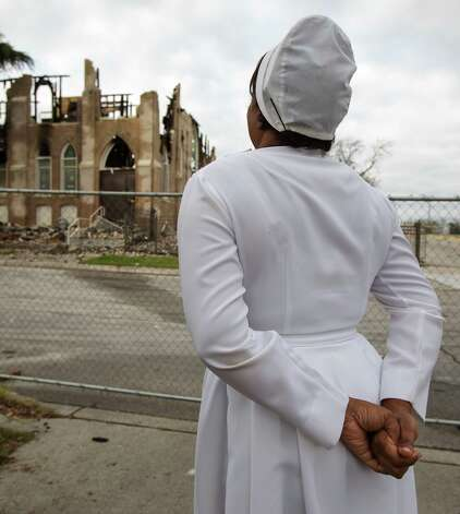 Patricia Palmer surveys the fire damage at the remains of the Childress Memorial Church of God in Christ at 901 N. Pine Street on Sunday, Feb. 3, 2013. Palmer said she had attended the church for over 40 years. Photo: Michael Miller, For The Express-News / For the Express-News