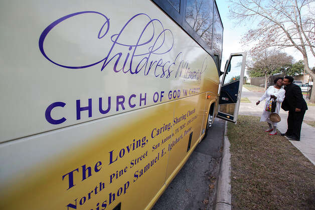 William Watson, right, greets Tia Forbes before they board a bus headed to the Convention Center near the remains of the Childress Memorial Church of God in Christ at 901 N. Pine Street on Sunday, Feb. 3, 2013. Photo: Michael Miller, For The Express-News / For the Express-News