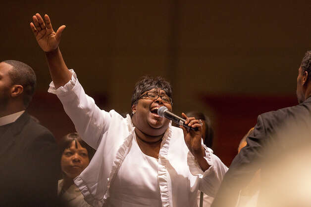 Members of the Childress Memorial Church of God in Christ choir sing during a service at the Gonzalez Convention Center on Sunday, Feb. 3, 2013. Photo: Michael Miller, For The Express-News / For the Express-News