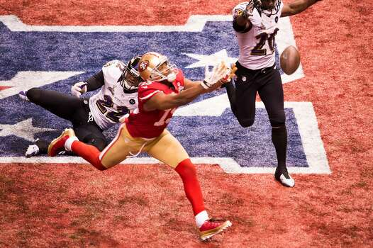 Colin Kaepernick's fourth-down pass - the 49ers' last best chance - floats beyond the reach of Michael Crabtree in the end zone with 1:46 left in the game. Photo: Smiley N. Pool, Chronicle