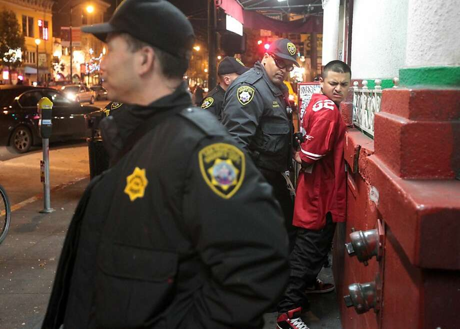 A man is arrested for being drunk in public on Valencia St. by Sheriff's personnel in San Francisco on Sunday, Feb. 3, 2013. Photo: Mathew Sumner, Special To The Chronicle
