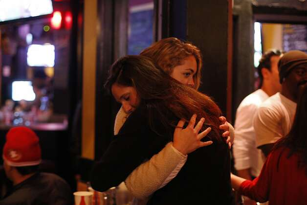 Arianna Deane hugs her friend outside of Giordano Bros. after the 49ers lost to the RavensMany on Sunday, Feb. 3. 49ers fans took to the Mission District to watch the Super Bowl. Photo: James Tensuan, The Chronicle