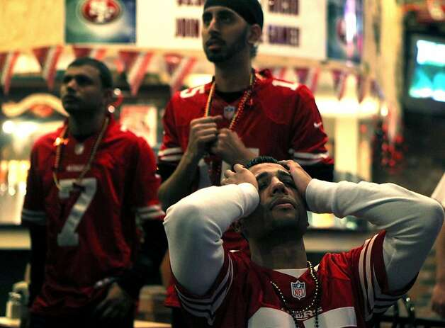 Dilber Atwal and his fellow 49er fans seem stunned that Colin Kaepernick team lost the Super Bowl to the Baltimore Ravens Sunday, Feb. 3, 2013. Residents of Kaepernick hometown viewed the game at Lamppost Pizza in Turlock Calif. Photo: Lance Iversen, The Chronicle