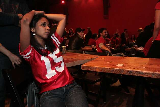 Forty-Niner fan Lara Ganesan sits dejectedly after her team lost the Super Bowl in San Francisco on Sunday, Feb. 3, 2013. Photo: Mathew Sumner, Special To The Chronicle