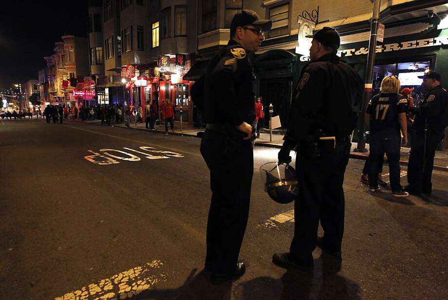 Police officers monitor the activity on Grant Avenue in North Beach in San Francisco, Calif. on Sunday, Feb. 3, 2013, after the 49ers lost to the Baltimore Ravens in the Super Bowl. Photo: Paul Chinn, The Chronicle