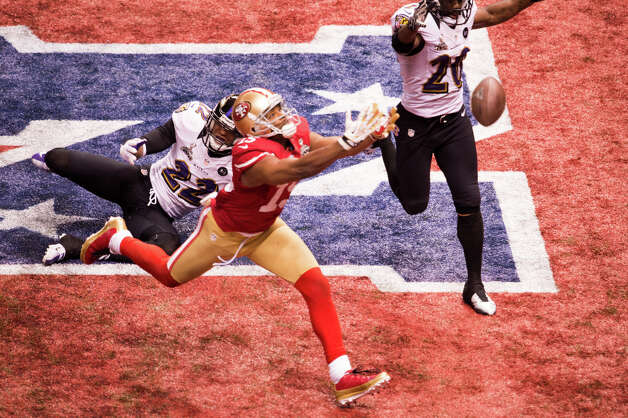 49ers wide receiver Michael Crabtree (15) has a pass go off his hands in the end zone on a fourth down attempt. Photo: Smiley N. Pool, Chronicle / © 2013  Houston Chronicle