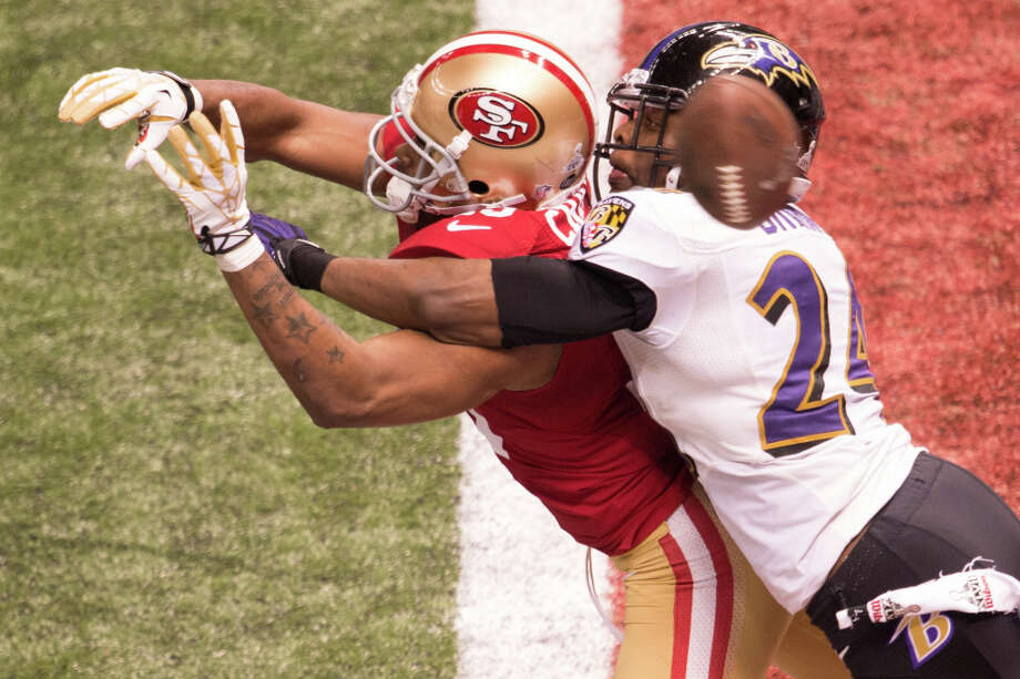 Ravens cornerback Corey Graham (24) breaks up a pass intended for 49ers wide receiver Michael Crabtree. Photo: Smiley N. Pool, Chronicle / © 2013  Houston Chronicle