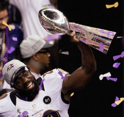 Ravens safety Ed Reed celebrates with the Lombardi Trophy. Photo: Smiley N. Pool, Chronicle / © 2013  Houston Chronicle