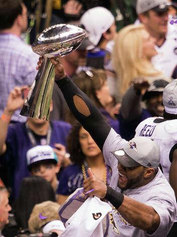 Ravens linebacker Ray Lewis celebrates with the Lombardi Trophy. Photo: Smiley N. Pool, Chronicle / © 2013  Houston Chronicle