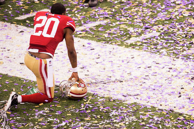 49ers defensive back Perrish Cox kneels on the field. Photo: Smiley N. Pool, Chronicle / © 2013  Houston Chronicle