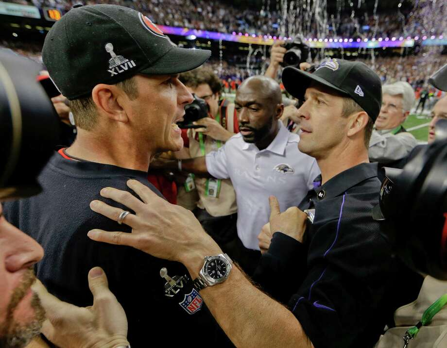 San Francisco 49ers head coach Jim Harbaugh, left, greets Baltimore Ravens head coach John Harbaugh after the Ravens defeated the 49ers 34-31 in the NFL Super Bowl XLVII football game, Sunday, Feb. 3, 2013, in New Orleans. (AP Photo/Dave Martin) Photo: Dave Martin