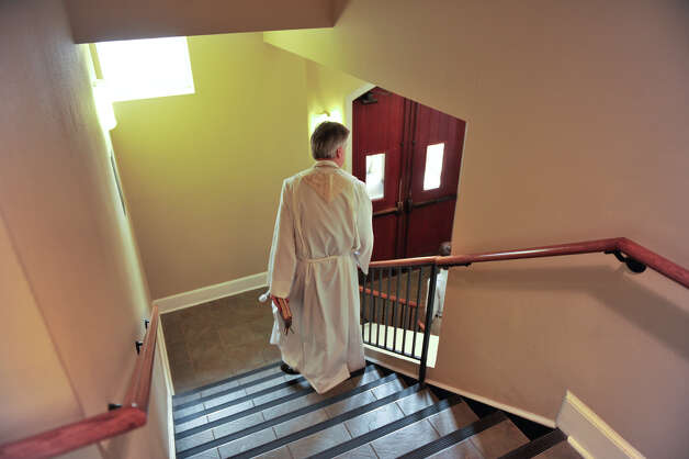 The Rev. Michael Chalk, rector at St. Mark's Episcopal Church, walks out to begin the rededication ceremony Sunday, Feb. 3, 2013, for the historic downtown church following a $15 million renovation. Photo: Robin Jerstad, For The Express-News