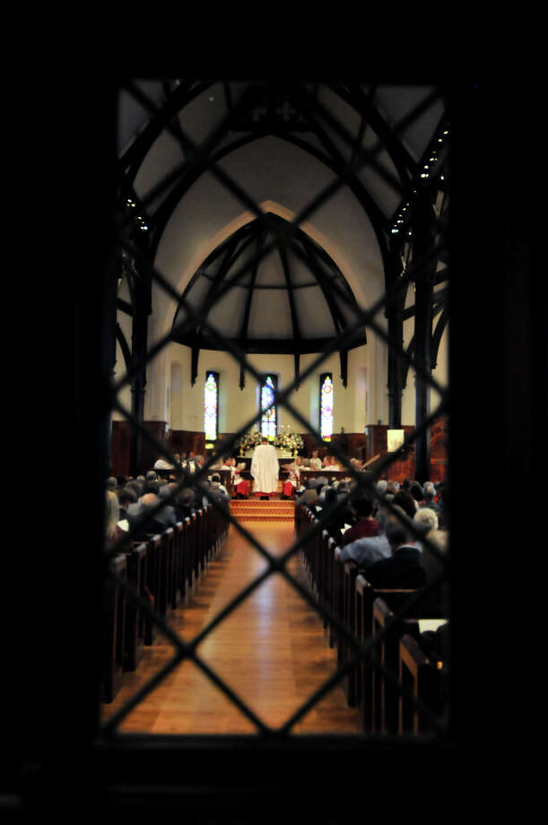 Leaded glass frames the rededication ceremony at St. Mark's Episcopal Church Sunday morning, Feb. 3, 2013, following a $15 million renovation to the historic downtown church. Photo: Robin Jerstad, For The Express-News