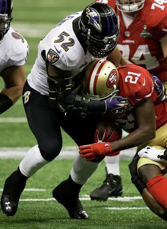 Baltimore Ravens inside linebacker Ray Lewis (52) tackles San Francisco 49ers running back Frank Gore (21) during the first half of the NFL Super Bowl XLVII football game, Sunday, Feb. 3, 2013, in New Orleans. (AP Photo/Elise Amendola) Photo: Elise Amendola / AP