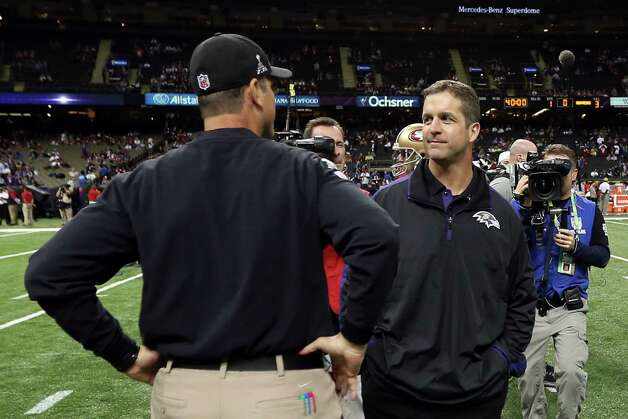 Head coach John Harbaugh of the Baltimore Ravens (R) and head coach Jim Harbaugh of the San Francisco 49ers speak during warm ups prior to Super Bowl XLVII at the Mercedes-Benz Superdome on February 3, 2013 in New Orleans, Louisiana. Photo: Chris Graythen, Getty Images / 2013 Getty Images