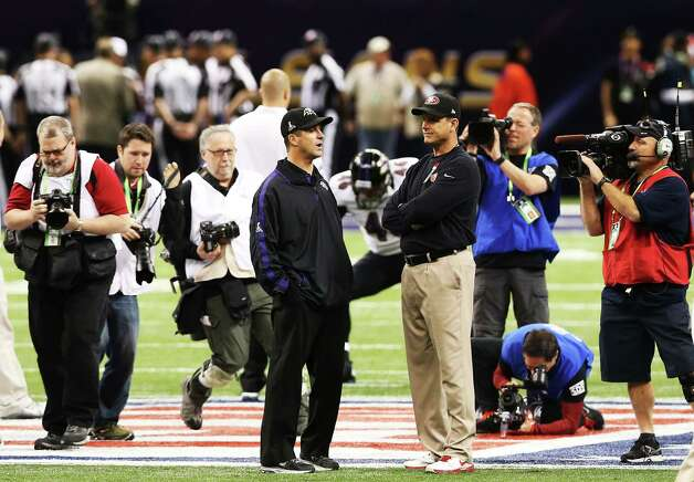 Head coach Jim Harbaugh (R) of the San Francisco 49ers and head coach John Harbaugh of the Baltimore Ravens talk on the field during Super Bowl XLVII at the Mercedes-Benz Superdome on February 3, 2013 in New Orleans, Louisiana. Photo: Ronald Martinez, Getty Images / 2013 Getty Images