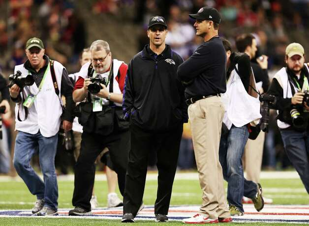 Head coach Jim Harbaugh (R) of the San Francisco 49ers and head coach John Harbaugh of the Baltimore Ravens talk on the field during Super Bowl XLVII at the Mercedes-Benz Superdome on February 3, 2013 in New Orleans, Louisiana. Photo: Christian Petersen, Getty Images / 2013 Getty Images
