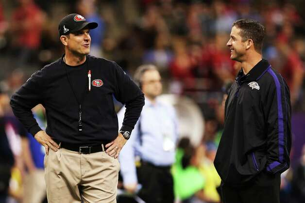 (L-R) Head coach Jim Harbaugh of the San Francisco 49ers and head coach John Harbaugh of the Baltimore Ravens talk on the field during Super Bowl XLVII at the Mercedes-Benz Superdome on February 3, 2013 in New Orleans, Louisiana. Photo: Christian Petersen, Getty Images / 2013 Getty Images
